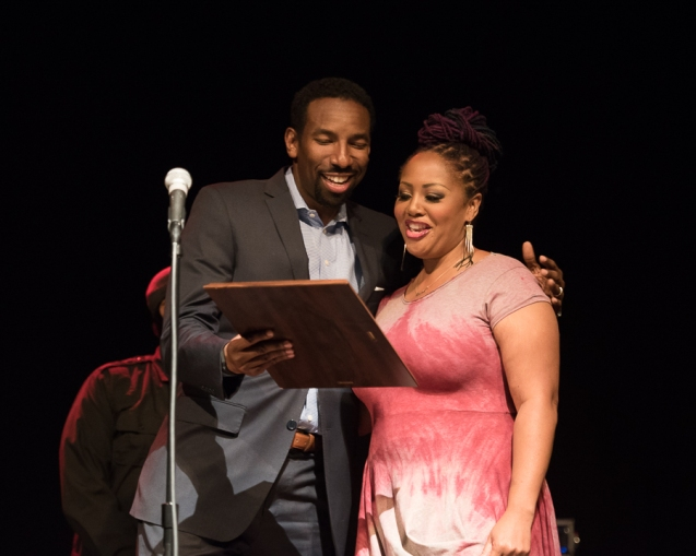 Councilman Andre Dickens presents a proclamation from the city of Atlanta